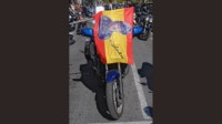 foto: 06 Homenaje Angel Nieto Madrid moto bandera.jpg