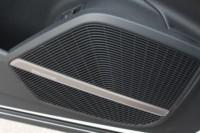 foto: 11c Prueba Audi Q5 2.0 TDI 190 quattro S tronic 2017 interior puerta altavos Bang&Olufsen.JPG