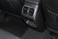 foto: 40 Prueba Kia Optima 2.0 GDI PHEV 2018 interior asientos traseros consola salidas aire toma 12v.JPG